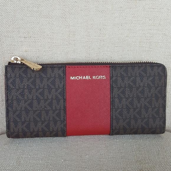 cdf1a311c24f MICHAEL Michael Kors Bags   Nwt Michael Kors Lg Stripe Wallet Brown ...